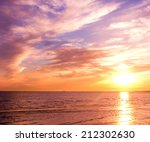 burning skies bay view  | Shutterstock . vector #212302630