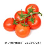 A Group Tomato On Vine On Whit...