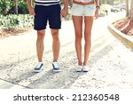 couple standing in the park and ... | Shutterstock . vector #212360548