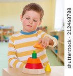 boy collects colored pyramid... | Shutterstock . vector #212468788