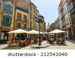 OVIEDO, SPAIN - JULY 17, 2014: People sitting at a terrace in the center of Oviedo, Asturias, Spain. - stock photo