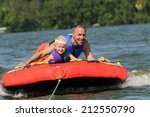 father tubing with his young... | Shutterstock . vector #212550790