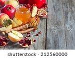 pomegranate  apple and honey ... | Shutterstock . vector #212560000