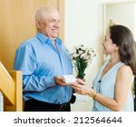 smiling mature man giving jewel ... | Shutterstock . vector #212564644