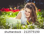 young woman with laptop on... | Shutterstock . vector #212575150