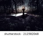 hand rising out from the grave | Shutterstock . vector #212582068