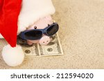 piggy bank with santa claus hat ... | Shutterstock . vector #212594020