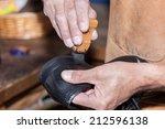 the shoemaker puts shoe polish | Shutterstock . vector #212596138
