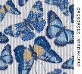 seamless knitted butterflies...   Shutterstock .eps vector #212603560