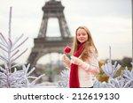 Girl with caramel apple on a Parisian Christmas market - stock photo