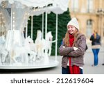 Cheerful girl on a Parisian street decorated for Christmas - stock photo