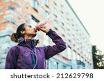 young woman drinking water... | Shutterstock . vector #212629798