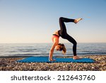 woman stretching in yoga... | Shutterstock . vector #212643760