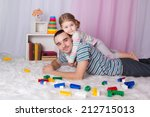 playing with dad at home on the ... | Shutterstock . vector #212715013
