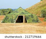 Camouflaged Military Tent At...