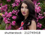 girl near the bush with roses | Shutterstock . vector #212745418
