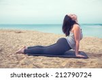young woman doing yoga exercise ... | Shutterstock . vector #212790724