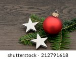 red xmas bauble lying on wood | Shutterstock . vector #212791618
