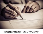 signing finance contract | Shutterstock . vector #212792899