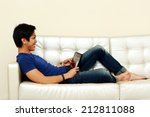 happy asian man lying on the... | Shutterstock . vector #212811088