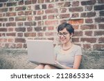 young hipster woman using... | Shutterstock . vector #212865334