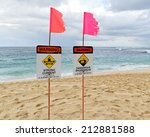 Signs On Sunset Beach Warn Off...