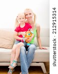 a mother and her daughter is... | Shutterstock . vector #212915314