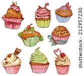 set of decorated sweet cupcakes ... | Shutterstock .eps vector #212957230