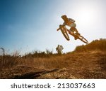 Bike jump. Downhill mountain biking. - stock photo