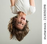 little boy hanging upside down | Shutterstock . vector #213050398