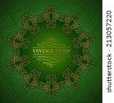 damask medallion over green... | Shutterstock .eps vector #213057220