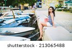 a beautiful girl at quay with... | Shutterstock . vector #213065488