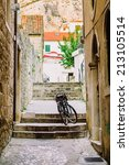 bicycle on the old narrow street | Shutterstock . vector #213105514