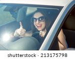 young smiling woman driving her ... | Shutterstock . vector #213175798