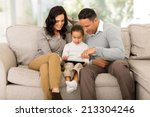 beautiful family using tablet... | Shutterstock . vector #213304246
