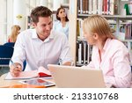 teacher helping mature student... | Shutterstock . vector #213310768