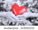 Red Heart In Hands On Grey...