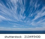 Wndy Clouds On The Evening Atlantic Ocean Sky
