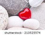Single Red Heart On Pebble...