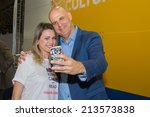 Small photo of Sao Paulo - Brazil - August - 23: American thriller writer Harlan Coben and unidentified fan at the International Biennial Book fair on august 23, 2014 in Sao Paulo, Brazil