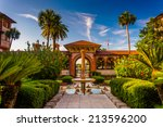 Fountain And Palm Trees At...