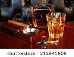 a glass of whiskey and cigar on ... | Shutterstock . vector #213645808