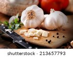 sliced garlic on wooden... | Shutterstock . vector #213657793