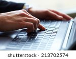 female hands on keyboard | Shutterstock . vector #213702574