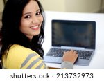young female student using... | Shutterstock . vector #213732973