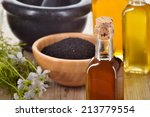 close up of nigella sativa oil... | Shutterstock . vector #213779554