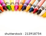 Multicolored Crayons On A Whit...