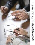 closeup of hands with financial ...   Shutterstock . vector #214002994