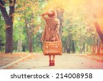 redhead girl with suitcase in... | Shutterstock . vector #214008958