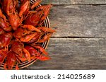 boiled crawfish on wooden surface